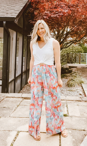 The Logan Pant features an elastic waistband making this one size pant perfect for most sizes!  Wear them high waisted with a knotted tank and sandals for an easy summer look, wear them over a tank bodysuit with heels for date night, or pop over your swimsuit this summer!