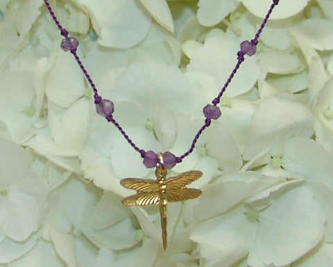 dragonfly pendant on purple silk necklace