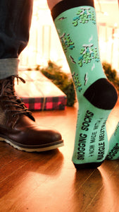 Mistletoe with nargles on green and black socks from weasley's wizard wheezes
