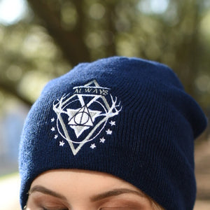 Blue white and gray deathly hallows symbol embroidered on a navy beanie