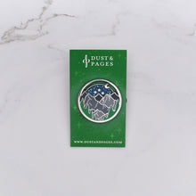 Load image into Gallery viewer, Glittery night sky enamel pin with a forest and mountains on a marble background
