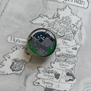 Glittering night court spinning enamel pin on a map of Prythian from ACOTAR