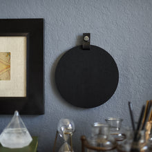 Load image into Gallery viewer, Round black felt board with black tab for organization hanging on an office wall