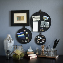 Load image into Gallery viewer, Three round black felt boards with black tabs for organization hanging on a living room wall