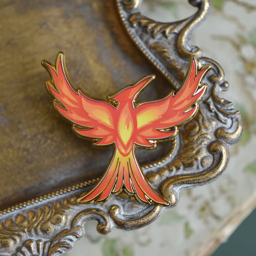 Mockingjay with red orange and yellow flame details enamel pin