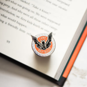 blackjack horse membership style pin on a Percy Jackson book