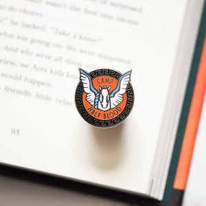 Pegasus horse membership style pin on a Percy Jackson book