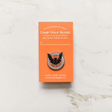 Load image into Gallery viewer, Blackjack horse with black mane and wings inside an orange and black circle enamel pin on an orange backing card