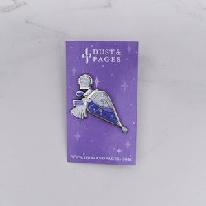 Purple and silver potion bottle enamel pin with a tag that says Reader Tears on a purple card