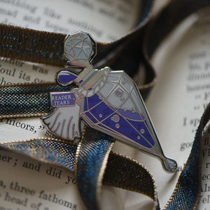 Purple and silver ornate potion bottle enamel pin with a tag that says Reader Tears