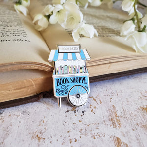Pastel color enamel pin on a open book