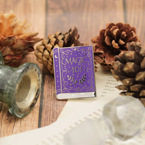 Wizardry and witchcraft purple magic spellbook enamel pin
