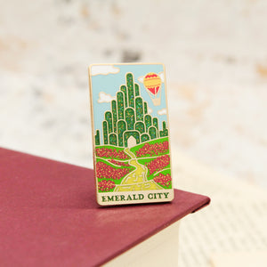 Emerald city and yellow brick road wizard of oz gold enamel pin