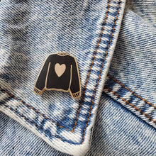 Load image into Gallery viewer, Black hand stamped heart sweater enamel pin on a jean jacket