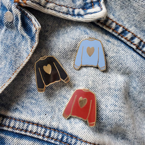 Maroon red black and blue hand stamped heart sweater enamel pin on a jean jacket
