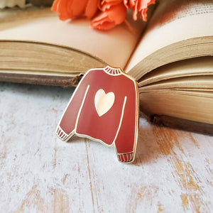 Maroon red hand stamped heart sweater enamel pin with a book