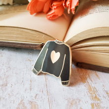 Load image into Gallery viewer, Black hand stamped heart sweater enamel pin with a book