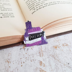 Wizardry and Witchcraft spellbook enamel pin