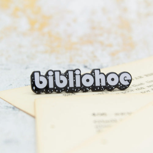 Funny black and white book lover enamel pin that says bibliohoe