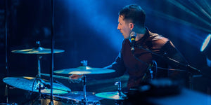 Mitch Ayling Drummer in the Milk playing live at Shepards Bush empire in colour with guardian quote