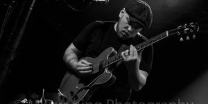 Dan Le Gresley Guitarist playing Gibson 335 live on stage at the jazz cafe black and white wearing a hat with metro quote