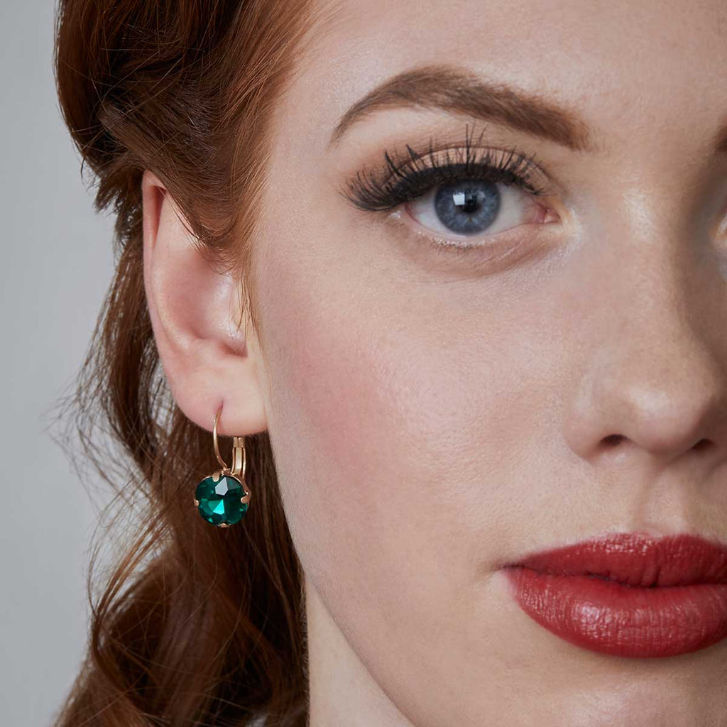 cushion cut earring in emerald inspired by the 1950s vintage inspired jewellery by lovett and co pictured on a model