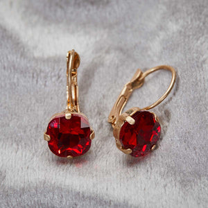 cushion cut earring in ruby vintage inspired 1950s jewellery by lovett and co pictured on a grey background