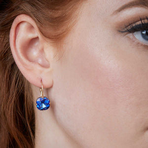 Cushion cut earring in Sapphire by Lovett and Co Vintage Inspired Jewellery 1950s earring pictured on a model