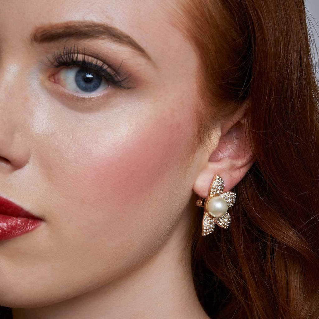 pearl flower clip earring by lovett and co pictured on a model.