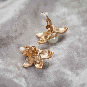 vintage inspired 1950's flower and pearl clip earring back pictured on a grey background by lovett and co