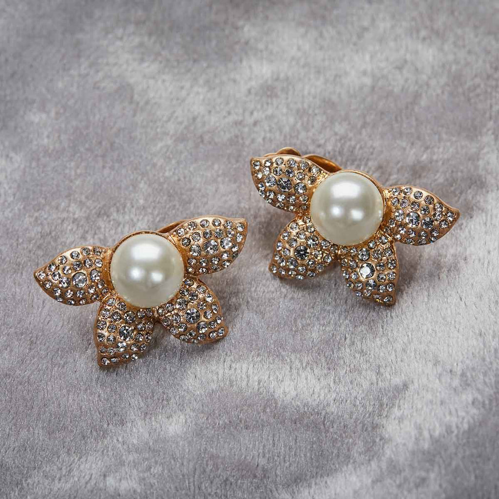 Pearl flower clip on earring, large pearl in the centre with diamantes encrusted on the flower pictured on a grey background 1950's vintage inspired earrings by lovett and co