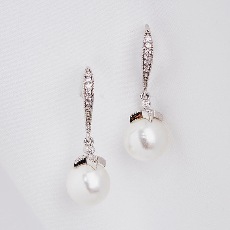 Image of 1950's inspired vintage style crystal drop earrings with cream pearls, perfect for wedding and any other special occasion
