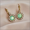 1950s vintage style stone drop earrings with clip fastening in light green colour