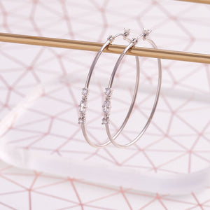 Image of silver plated hoop earrings in contemporary style