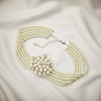 Audrey Hepburn Pearl Necklace inspired by Breakfast at Tiffanys. 5 rows of pearl and glass with a stunning centre piece