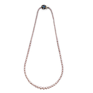 vintage inspired dusky pink pearl necklace by lovett and co, pictured on a white background. costume jewellery