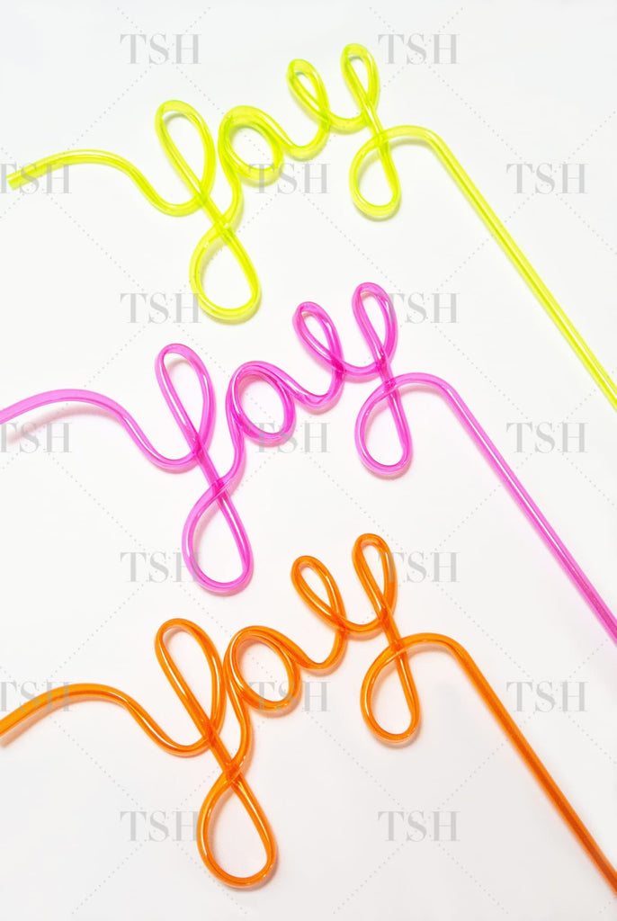 YAY Script party straws in pink, orange, and yellow on white background.