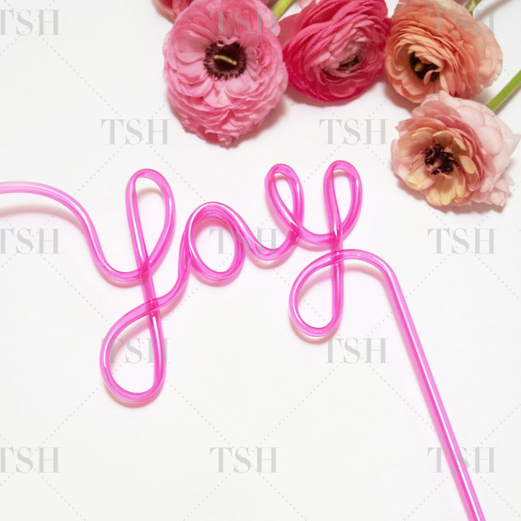 YAY Script pink party straw and spring flowers on white background.