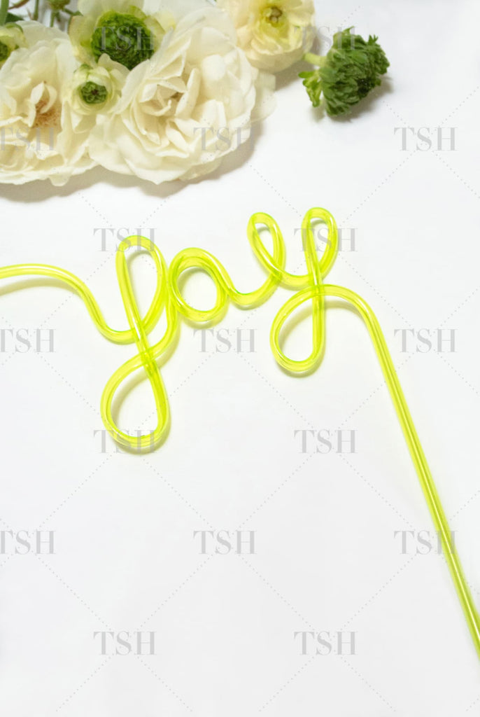 YAY Script yellow party straw and spring flowers on white background.