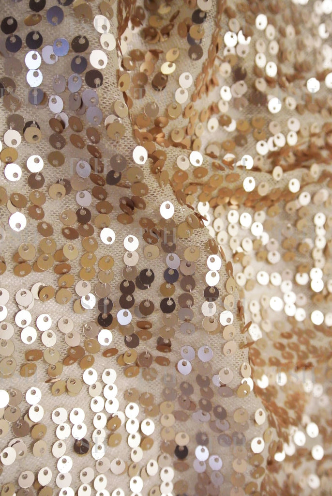 Sparkling neutral nude sequin textile background.