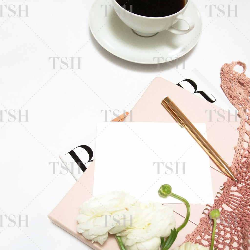 Blush crochet market tote with white flowers, fashion magazine, daily planner, stationery mockup, gold pen, and coffee.
