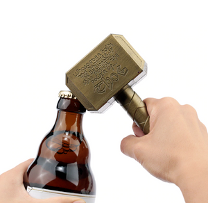 Okeegadgets Hammer of Thor Bottle Bronze Gold Bottle Opener In Use Shown With Beer