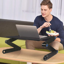 Load image into Gallery viewer, okeegadgets-black-adjustable-foldable-portable-laptop-desk-shown-with-model-eating