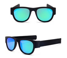 Load image into Gallery viewer, okeegadgets-black-frame-blue-lens-polarized-slap-sport-foldable-wristband-sunglasses