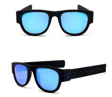 Load image into Gallery viewer, okeegadgets-black-blue-polarized-slap-sport-foldable-wristband-sunglasses