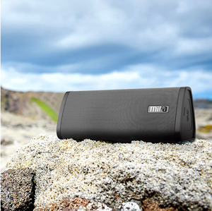 okeegadgets-portable-water-resistant-bluetooth-speaker-black-on-rock-outdoors-view