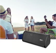 Load image into Gallery viewer, okeegadgets-portable-water-resistant-bluetooth-speaker-black-version-with-festival-lifestyle-image