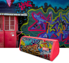 Load image into Gallery viewer, okeegadgets-portable-water-resistant-bluetooth-speaker-red-graffiti-version-graffiti-with-graffiti-wall-in-background