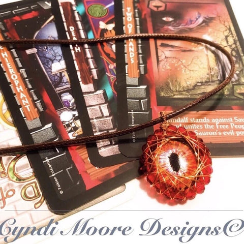 Red, Orange, and Gold Hand painted Dragon's Eye with Crystal Wire Wrap