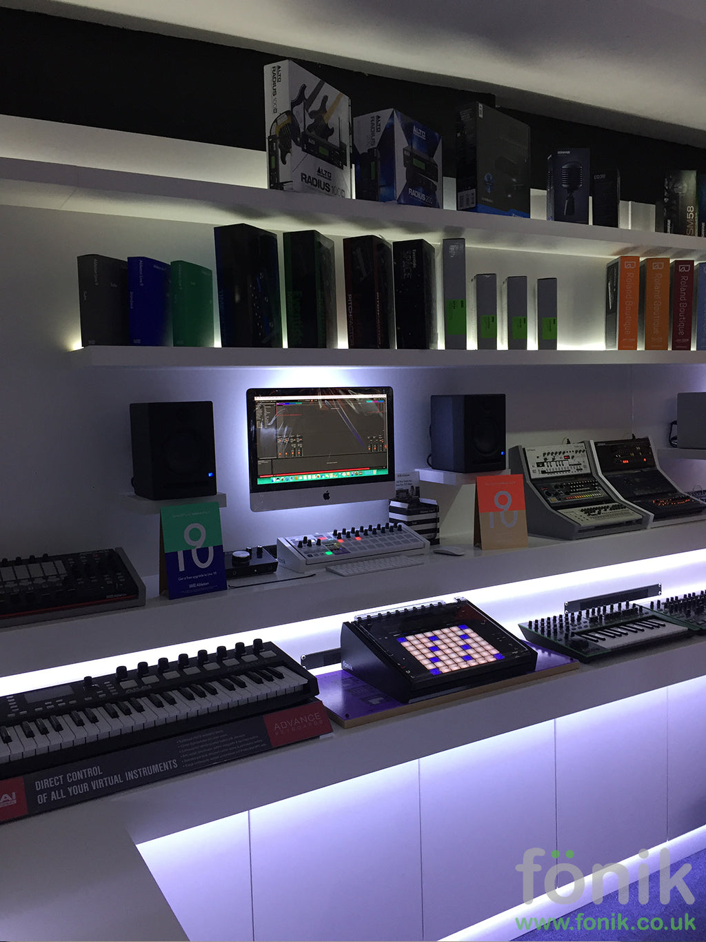 Fonik Bespoke Shop Fit and Arturia Beatstep stand in white